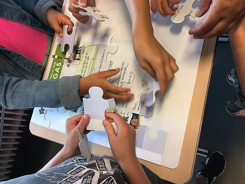 Students playing puzzle game